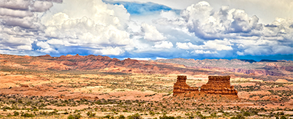 Arizona desert with buttes and big clouds